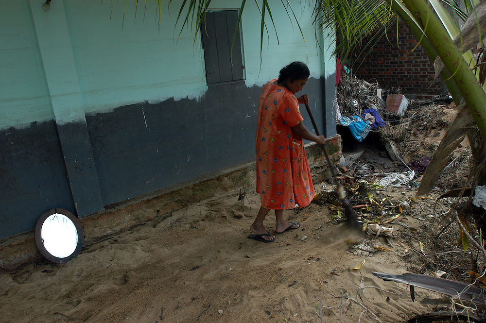 Victims of the December 26, 2004 Tsunami begin to return to their devastated homes from displaced person's camps to start the process of clearing away the debris and picking up the pieces of their lives..Batticaloa, Sri Lanka. 11/01/2005.Photo © J.B. Russell