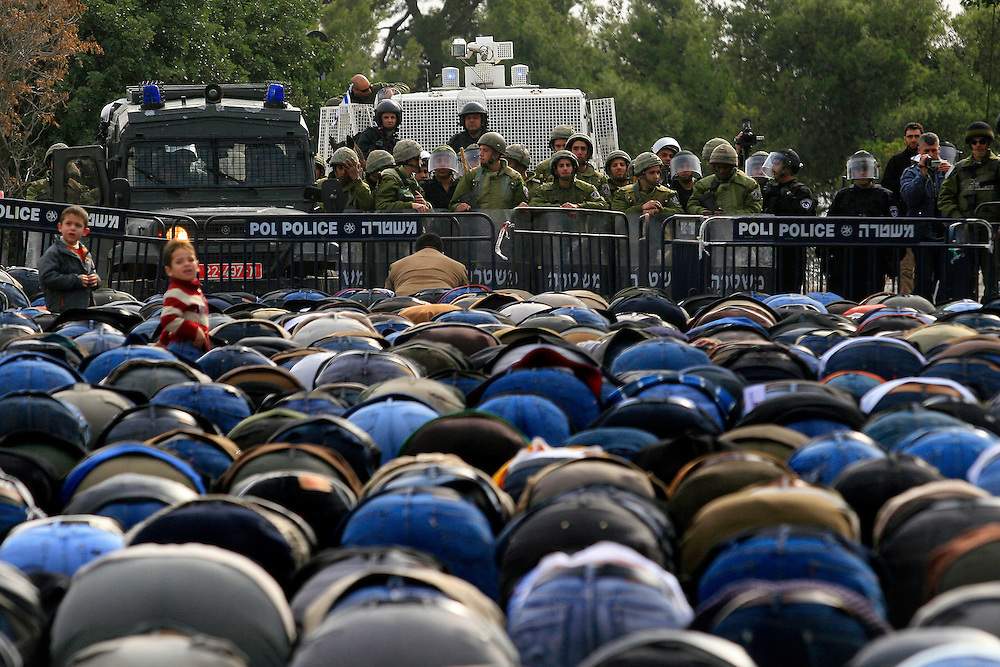 Muslim Palestinian worshipers face anti-riot Israeli police in East Jerusalem on January 16, 2009 after they were prevented from entering the al-Aqsa mosque compound in Jerusalem s old city for the Friday noon prayer. Photo by Olivier Fitoussi /FLASH90