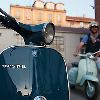 MILAN, ITALY - JUNE 05:  A participant arrives for the start of the Vespa race on June 5, 2010 in Milan, Italy. Vespa is one of the best known Italian icons, the special Vespa weekend is the XV edition of the famous  500km night race  (Photo by Marco Secchi/Getty Images)