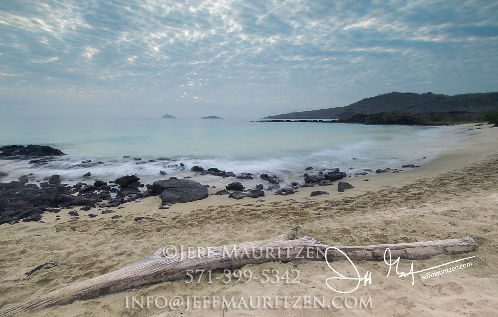 Sunrise over a beach on Floreana island, part of the Galapagos islands of Ecuador.