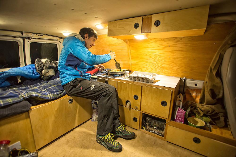 Climber Alex Honnold cooking dinner in his van