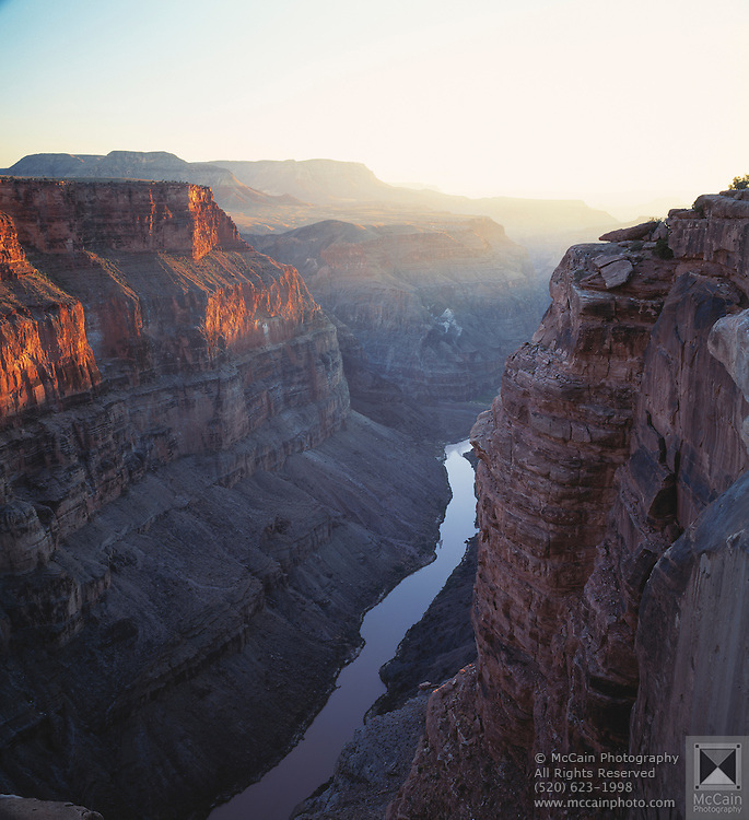 Westward view from Toroweap Point at sunset, almost 3,000 feet straight down to the Colorado River and the western end of Grand Canyon, Grand Canyon National Park, Arizona...Subject photograph(s) are copyright Edward McCain. All rights are reserved except those specifically granted by Edward McCain in writing prior to publication...McCain Photography.211 S 4th Avenue.Tucson, AZ 85701-2103.(520) 623-1998.mobile: (520) 990-0999.fax: (520) 623-1190.http://www.mccainphoto.com.edward@mccainphoto.com.