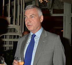 DAVID BURNSIDE at a party to celebrate the publication of Right or Wrong: The Memoirs of Lord Bell held at Mark's Club, Charles Street, London on 16th October 2014.