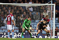 Photo: Rich Eaton.<br /> <br /> Aston Villa v Manchester City. The Barclays Premiership. 29/11/2006. Olof Mellberg of Aston Villa and Joey Barton of City clash in the penalty box