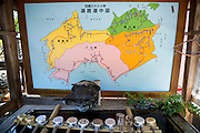Map of the Shikoku Island and the pilgrimage. Water for prayers at the first temple Ryōzen-ji (霊山寺) of the Shikoku Pilgrimage, 88 temples associated with the Buddhist monk Kūkai (Kōbō Daishi) on the island of Shikoku, Naruto,	Tokushima Prefecture, Japan
