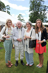 Left to right, LEONORA SURTEES, JOHN SURTEES, his wife JANE and EDWINA SURTEES at a luncheon hosted by Cartier for their sponsorship of the Style et Luxe part of the Goodwood Festival of Speed at Goodwood House, West Sussex on 1st July 2012.
