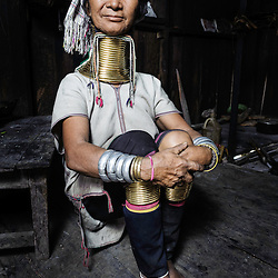 Portrait of a Padaung woman in her house, Loikaw area, Myanmar, Asia