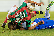 Portugal, FUNCHAL : Maritimo's Brazilian defender Raul Silva falls on Porto's Colombian forward Jackson Martinez  during Portuguese League football match Maritimo vs F.C. Porto Stadium in Funchal on January  25, 2015. PHOTO/ GREGORIO CUNHA