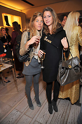 Left to right, COSIMA UNGARO and VALENTINE CAILLE at a party to celebrate the arrival of the 'A Princess to be a Queen' collection at the Roger Vivier boutique on Sloane Street, London on 20th October 2009.