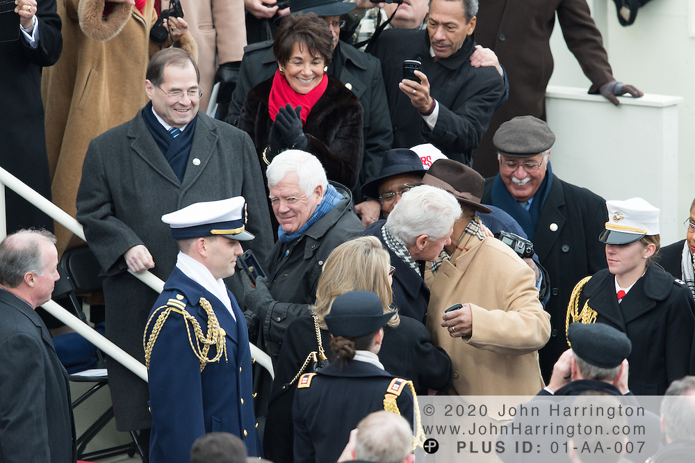 Former President Bill Clinton and Secretary of State Hillary Rodham Clinton arrive at the 57th Presidential Inauguration of President Barack Obama at the U.S. Capitol Building in Washington, DC January 21, 2013.