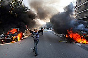 Fresh violence erupted on the Gaza streets as three cars were set ablaze during a fire fight between gunmen from Fatah and Hamas December 20,2006. (Photo by Heidi Levine/Sipa Press).