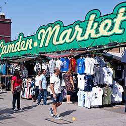 People walk past the Camden Market in London on August 21, 2013. Camden Town is London's most popular open-air market area with stalls, shops, pubs and restaurants.