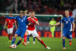 30.05.2014, Tivoli Stadion, Innsbruck, AUT, Fussball Testspiel, Oesterreich vs Island, im Bild (v.l.) Birkir Bjarnason (ISL), Marc Janko (AUT), Emil Hallfredsson (ISL) // Iceland's Birkir Bjarnason (L) in action against Austrian's Marc Janko (M) and Iceland's Emil Hallfredsson (R) during the International Friendly between Austria and Iceland at the Tivoli Stadion in Innsbruck, Austria on 2014/05/30. EXPA Pictures © 2014, PhotoCredit: EXPA/ Johann Groder