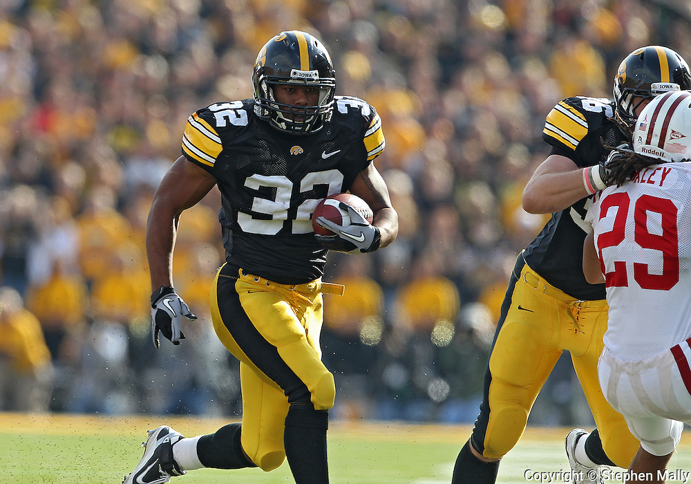 October 23 2010: Iowa Hawkeyes running back Adam Robinson (32) on a run during the first half of the NCAA football game between the Wisconsin Badgers and the Iowa Hawkeyes at Kinnick Stadium in Iowa City, Iowa on Saturday October 23, 2010. Wisconsin defeated Iowa 31-30.