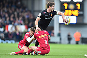 Ollie Devoto of Exeter Chiefs passes the ball as he is tackled during the Aviva Premiership match between Exeter Chiefs and Harlequins at Sandy Park, Exeter, United Kingdom on 19 November 2017. Photo by Graham Hunt.