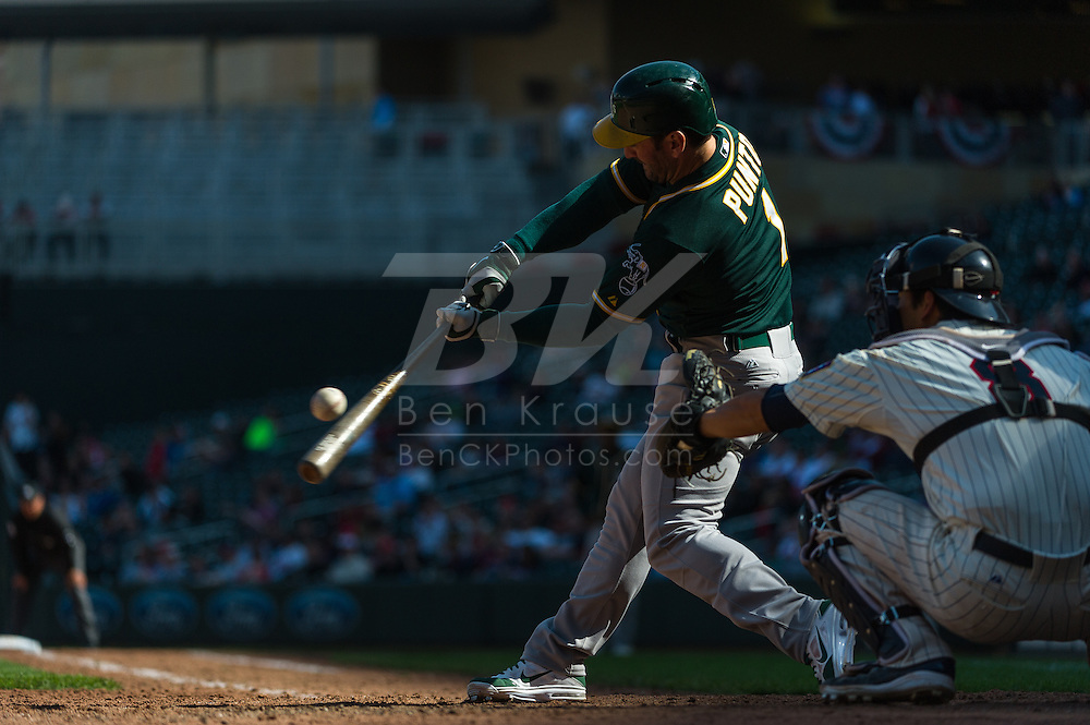 Nick Punto #1 of the Oakland Athletics bats against the Minnesota Twins on April 9, 2014 at Target Field in Minneapolis, Minnesota.  The Athletics defeated the Twins 7 to 4.  Photo by Ben Krause