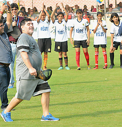 December 12, 2017 - Kolkata, West Bengal, India - Argentina's soccer legend Diego Maradona , gestures during a football workshop with school students in Barasat, around 38 Km north of Kolkata on December 12, 2017. Maradona is on a private visit to India. (Credit Image: © Debajyoti Chakraborty/NurPhoto via ZUMA Press)