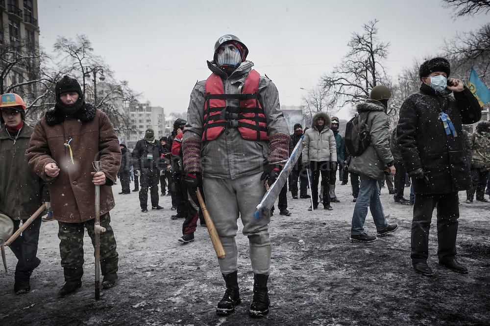 Violent clashes opposed protesters and riot police on Hrushevskoho street, near Maidan Square, with baricades and police trucks set on fire in Kiev, 22 January 2014.