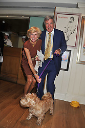 HARRY & RUTH FITZGIBBONS and their dog Romeo at the 10th anniversary of George in association with The Dog's Trust held at George, 87-88 Mount Street, Mayfair, London on 13th September 2011.