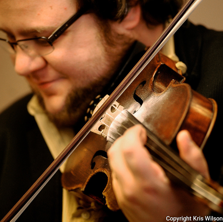Kris Wilson/News Tribune.The Rage fiddle player Hunter Berry warms up in the artists' room before the band takes the stage with bluegrass superstar Rhonda Vincent for their first set of the day during the opening day of the 38th annual Society for the Preservation of Bluegrass Music of America (SPBMA) Bluegrass Music Awards and 29th annual Midwest Convention at the Capitol Plaza Hotel on Friday.