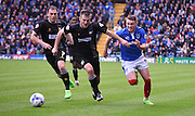 Caolan Lavery looks to break past the Mansfield defence during the Sky Bet League 2 match between Portsmouth and Mansfield Town at Fratton Park, Portsmouth, England on 24 October 2015. Photo by Michael Hulf.