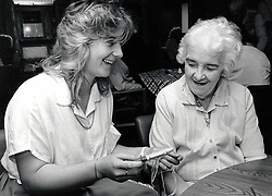 Care worker with elderly woman in residential care home, Nottingham, UK 1987