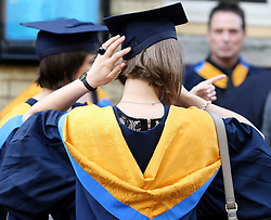 File photo dated 12/10/11 of graduates. Teenagers from poorer backgrounds are more likely to be put off applying to university due to concerns about debt, according to a study.