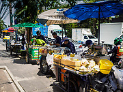 24 MARCH 2017 - BANGKOK, THAILAND: Street food carts on Sukhumvit Soi 63 (Ekkamai). These carts are being evicted from the area. Food cart vendors along Sukhumvit Road between Sois 55 (Thong Lo) and 69 (Phra Khanong) in Bangkok have been told by city officials that they have to leave the area by 17 April. It's a part of an effort by Bangkok city government, supported by the ruling junta, to take back the city's sidewalks. The evictions in the area are the latest in mass evictions of Bangkok street food vendors after similar actions elsewhere on Sukhumvit, in the Ari area, in Silom/Patpong and Ratchaprasong neighborhoods. The vendors in Thong Lo/Phra Khanong are popular with local office workers because most of the formal restaurants in the area serve foreign tourists and upper class Thais and are very expensive. The street food carts serve meals starting at about 35Baht ($1US). The city has not announced if they will provide alternative locations for the carts.     PHOTO BY JACK KURTZ