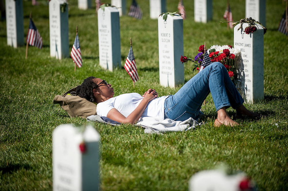 On Memorial Day, Andrea Roe, 34, of Detriot Michigan, visits the grave of her brother Vincent James Bell at Arlington National Cemetery in Arlington, Virginia, USA, on 26 May 2014. Bell was killed in action in Afghanistan in 2011.
