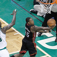 03 June 2012: Miami Heat point guard Mario Chalmers (15) goes for the reverse layup past Boston Celtics power forward Kevin Garnett (5) during the second quarter of Game 4 of the Eastern Conference Finals playoff series, Heat at Celtics, at the TD Banknorth Garden, Boston, Massachusetts, USA.