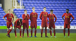 READING, ENGLAND - Wednesday, March 12, 2014: Liverpool's players look dejected after losing 5-4 on penalties after a 4-4 draw against Reading during the FA Youth Cup Quarter-Final match at the Madejski Stadium. Jordan Rossiter, Harry Wilson, Daniel Trickett-Smith, Daniel Cleary, Jordan Williams, Sergi Canos, Sheyi Ojo (Pic by David Rawcliffe/Propaganda)
