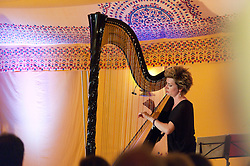 © Licensed to London News Pictures. 03/06/2016. Hay-on-Wye, Powys, Wales, UK. Harpist Catrin Finch gives a performance at the Globe site on the ninth day of 'HowTheLightGetsIn' Festival of Ideas - The philosophy and music festival at Hay-on-Wye, Wales, UK. HowTheLightGetsIn festival was founded by post-realist philosopher and director of the Institute of Art and Ideas, Hilary Lawson. Photo credit: Graham M. Lawrence/LNP