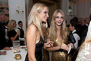 POPPY DELEVIGNE; CARA DELEVIGNE, Harper's Bazaar Women Of the Year Awards 2011. Claridges. Brook St. London. 8 November 2011. <br /> <br />  , -DO NOT ARCHIVE-© Copyright Photograph by Dafydd Jones. 248 Clapham Rd. London SW9 0PZ. Tel 0207 820 0771. www.dafjones.com.