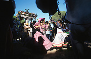 """Dancing Sevillanas. The pilgrim route of the Hermandade de Sanlucar de Barrameda from Sanlucar across the Parque Donana to El Rocio, Huelva Province, Andalusia, Spain...El Rocio follows on from Semana Santa - Easter week and the various spring ferias, of which Seville's Feria de Abril (April) is the biggest. The processions to the (Hermitage) Hermita de El Rocío, at Pentecost, is the most famous (Romeria) pilgrimage in the Andalusian region, attracting nearly a million people from across Andalusia, Spain and the world. The cult started off in the 13th century when a statue of the virgin Mary was apparently found in a tree trunk in the Donana Park. What was first a local devotion at Pentecost by local pilgrim brotherhoods """"hermandades"""" became by the 19th century into dozens of fraternities developed from such as Cadiz, Selville and Huelva. Some walk for several days, others travel with oxen drawn wagons or on horseback, with traction engines and all terrain vehicles, camping along the trail they take. They wear Andalusian costumes, tight breeches, boots, short jackets and frilly flamenco skirts. Many festivities, flamenco dance, laments, songs and music are combined with religious prayers. Devout pilgrims walk as a penance, keeping vows of silence. An emblem of the immaculate conception (sin peche) is carried. On the Pentecost after the stroke of midnight on the whit Sunday the virgin Mary is carried from the church through the streets of El Rocio by each hermandade to visit each brotherhood's shrine."""