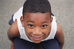 Portrait of primary school boy in playground,