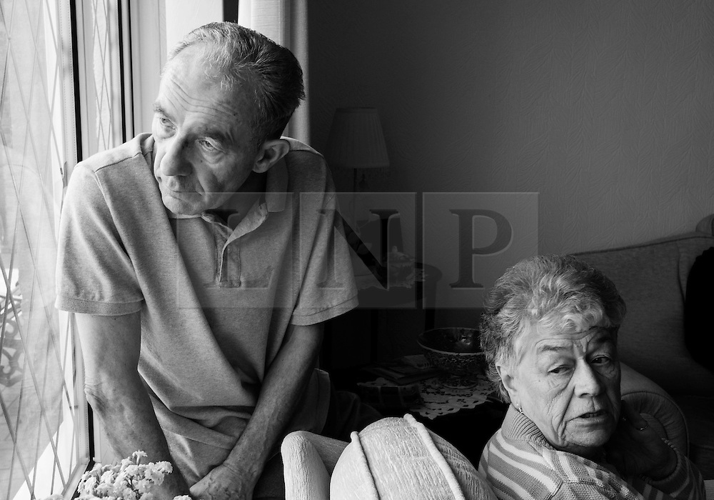 © Licensed to London News Pictures. 09/04/2014<br /> These photographs have been converted to black and white<br /> <br /> Durham, United Kingdom<br /> <br /> Parkinson's Disease sufferer David Forsyth from Brandon, County Durham and his wife Judy sit and look out of the window as they talk about his illness.<br /> <br /> Parkinson's is a long-term neurological condition that affects the way the brain co-ordinates body movements including walking, talking and writing and affects both men and women.<br /> <br /> Photo credit : Ian Forsyth/LNP