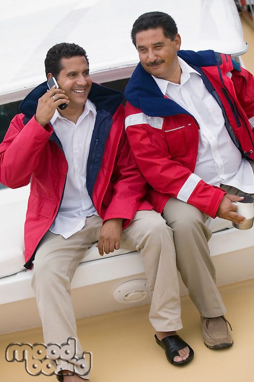 Friends on Boat with Cell Phone