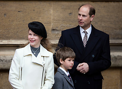 WINDSOR - UK - 27th Mar 2016: HM Queen Elizabeth, accompanied by HRH The Duke , The Duke and members of the royal family attends the annual Easter Sunday service at St George's Chapel in the grounds of Windsor Castle.<br /> <br /> Prince Andrew with children James and Louise<br /> Photograph by Ian Jones.