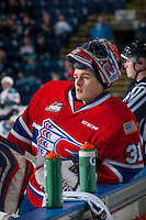KELOWNA, CANADA - MARCH 7: Tyson Verhelst #31 of Spokane Chiefs stands at the bench during warm up against the Kelowna Rockets on March 7, 2015 at Prospera Place in Kelowna, British Columbia, Canada.  (Photo by Marissa Baecker/Shoot the Breeze)  *** Local Caption *** Tyson Verhelst;