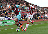Geoff Cameron of Stoke City and Robert Snodgrass of West Ham United in action during the Premier League match at the Bet 365 Stadium, Stoke-on-Trent.<br /> Picture by Michael Sedgwick/Focus Images Ltd +44 7900 363072<br /> 29/04/2017