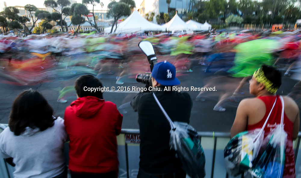 Runners take off from Dodger Stadium during the 31st Los Angeles Marathon in Los Angeles, Sunday, Feb. 14, 2016. The 26.2-mile marathon started at Dodger Stadium and finished at Santa Monica.  (Photo by Ringo Chiu/PHOTOFORMULA.com)<br /> <br /> Usage Notes: This content is intended for editorial use only. For other uses, additional clearances may be required.