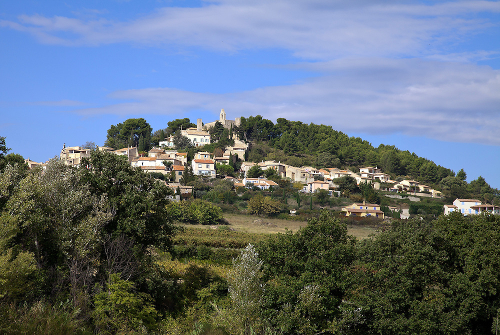 Typical of many small hill villages in Provence, Rasteru is blink-small on the D875 road between Vaison-la Romaine and Orange inthe Vaucluse department of Provence, in  Southern France.