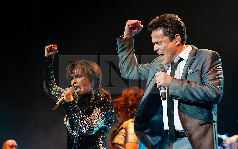 "© Licensed to London News Pictures. 20/01/2013. London, UK.   Donny and Marie Osmond performing live at The O2 Arena, on the opening night of their Donny & Marie Live tour Sunday 20 January 2013.  .Donald Clark ""Donny"" Osmond (born December 9, 1957) is an American singer, musician, actor, dancer, radio personality, and former teen idol. Donny Osmond has also been a talk and game show host, record producer and author. In the mid 1960s, he and four of his elder brothers gained fame as The Osmonds on the long running variety program, The Andy Williams Show. Donny went solo in the early 1970s covering such hits as ""Go Away Little Girl"" and ""Puppy Love""...Olive Marie Osmond (born October 13, 1959) is an American singer, actress, doll designer, and a member of the show business family The Osmonds. Although she was never part of her family's singing group, she gained success as a solo country music artist in the 1970s and 1980s. .For over thirty-five years, Donny and Marie have gained fame as Donny & Marie, partly due to the success of their 1976-79 self-titled variety series, which aired on ABC. The duo also did a 1998-2000 talk show and have been headlining in Las Vegas since 2008.   Photo credit : Richard Isaac/LNP"