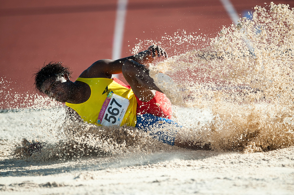 Oct. 25, 2011 - Guadalajara, Mexico - Hugo Dionicio Chila of Ecuador  in the men's long jump final during athletics at Telmex Athletics Stadium on day eleven of the XVI Pan American Games. Dionicio finished in eleventh place..©Benjamin B Morris