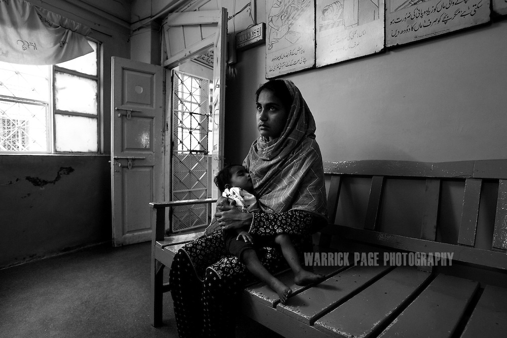 KARACHI, PAKISTAN - MARCH 5: A battered wife arrives at the Edhi centre seeking shelter from her abusive husband on March 5, 2008 in Karachi, Pakistan. The Edhi Foundation urges women give up unwanted children rather than abandon or kill in order to cover up children conceived out of wedlock, or through rape. The Edhi Foundation orphanages represent a microcosm of Pakistan's absolute poverty where children are its first casualty, tragedy and hope collide on a daily basis, and life and death are in constant flux existing only rooms apart. Pakistan is a country more than a third of it's population live in absolute poverty. As world attention fixates on Pakistan's ongoing political turmoil, generations of children are being abandoned due to Pakistan's spiraling poverty and growing instability. Some are born out of wedlock - a major social taboo - others discarded due to physical and mental disabilities, but nearly all are abandoned due to poverty. Boys and girls alike are abandoned every year, found in dumpsters mauled by rats and dogs, or left to fend for themselves on the streets of Karachi's sprawling and unforgiving metropolis. The lucky ones find their way to the Edhi Foundation orphanages. (Photo by Warrick Page)