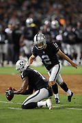 Oakland Raiders punter Marquette King (7) holds while Oakland Raiders kicker Giorgio Tavecchio (2) kicks a third quarter field goal that ties the score at 10-10 during the 2017 NFL week 4 preseason football game against the Seattle Seahawks, Thursday, Aug. 31, 2017 in Oakland, Calif. The Seahawks won the game 17-13. (©Paul Anthony Spinelli)