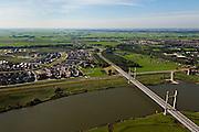 Nederland, Overijssel, Kampen, 03-10-2010; tuibrug over de IJssel naar Kampen-Zuid, in het verschiet is de Hanzelijn reeds zichtbaar, Flevoland aan de horizon..Cable-stayed bridge across the IJssel at Kampen-South, at the horizon the Hanzelijn is already visible, Flevoland in the background..luchtfoto (toeslag), aerial photo (additional fee required).foto/photo Siebe Swart