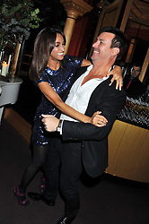 NICK COWELL and JACKIE ST.CLAIRE at the 39th birthday party for Nick Candy in association with Ciroc Vodka held at 5 Cavindish Square, London on 21st Januatu 2012.