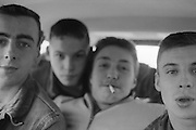Symond, Sean, Ray and Friend in a car, High Wycombe, UK, 1980s