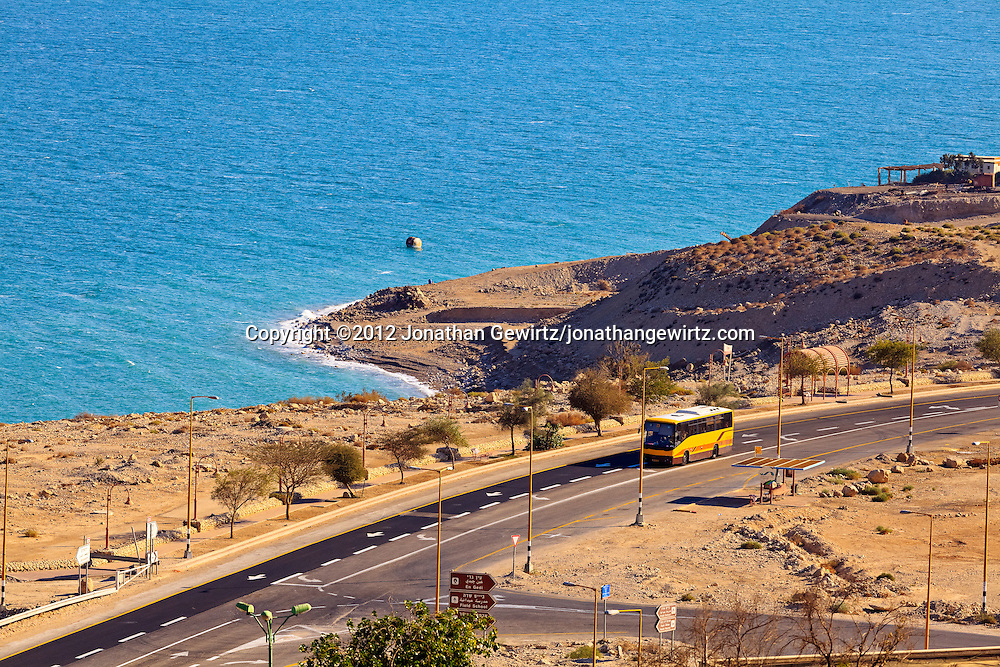 Traffic on Highway 90 along the western Dead Sea coast passes Ein Gedi's public beach and the entrance to the Ein Gedi nature preserve. WATERMARKS WILL NOT APPEAR ON PRINTS OR LICENSED IMAGES.